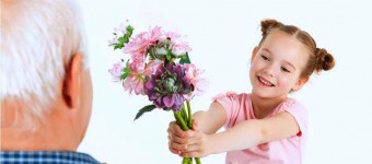 young girl giving flowers